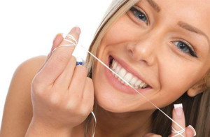 higiene bucal con seda dental